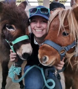 Lize Louw with a miniature horse and miniature donkey